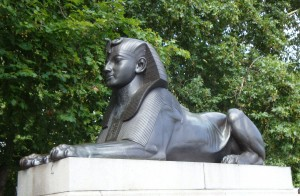 Two Victorian replicas of sphinxes crouch on either side of Cleopatra's Needle. The sphinxes are cast in bronze and have hieroglyphic inscriptions. They were designed by the English architect George John Vulliamy and were installed when the obelisk was erected on the bank of the River Thames in 1878. Unfortunately, the position of the two sphinxes seems to indicate a misunderstanding of their role. Because they both face the obelisk, they seem to be looking at the Needle rather than guarding it.
