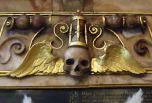 This skull with its hourglas hat is a tiny detail on a memorial in the church of St. Mary's Putney, next to Putney Bridge.